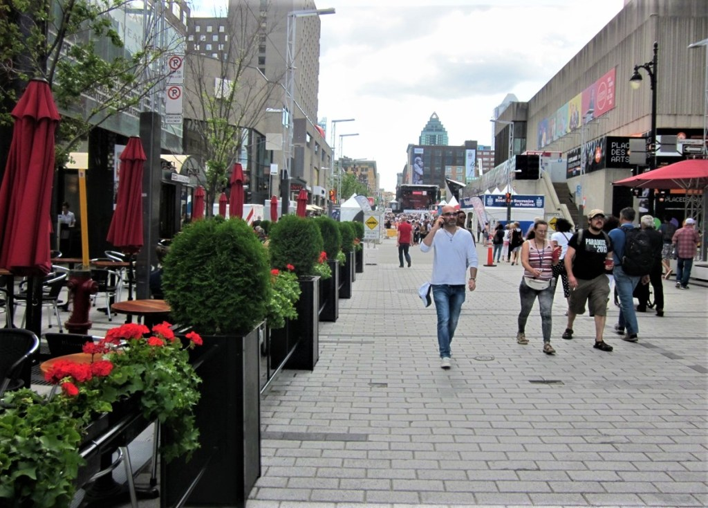 People are walking along St Catherine in Montreal