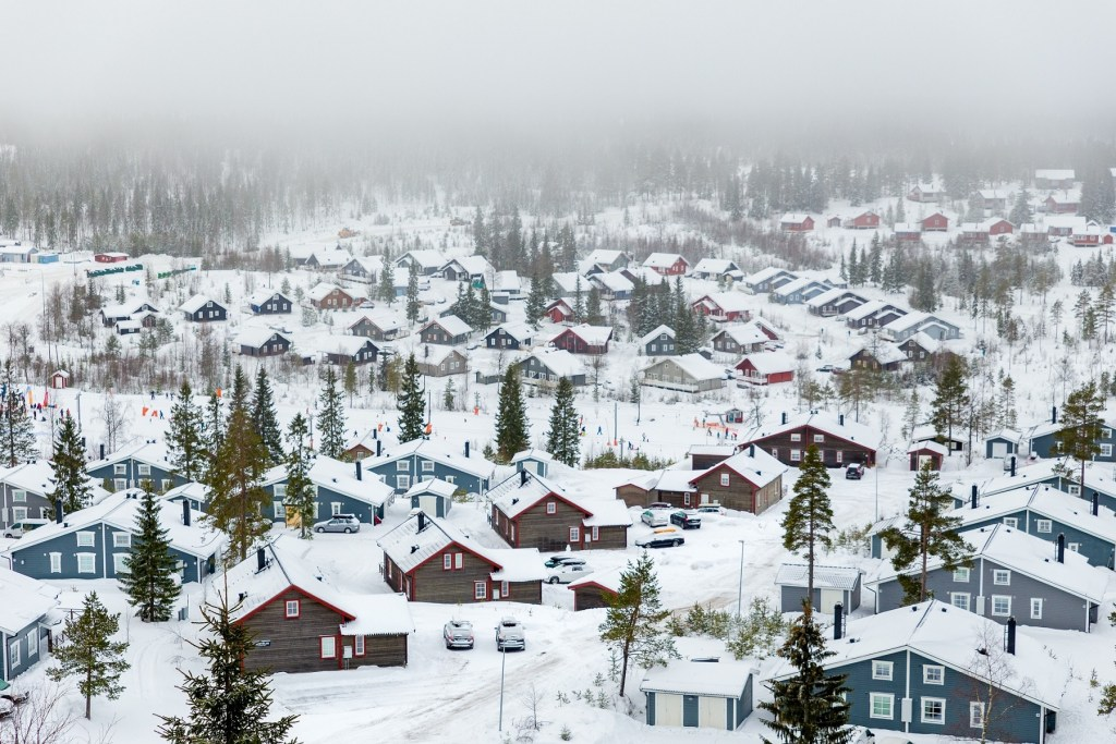 small town houses covered with snow - downsizing in retirement