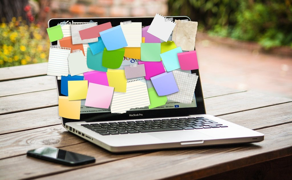 bulletin board with sticky notes - organize your finances for retirement