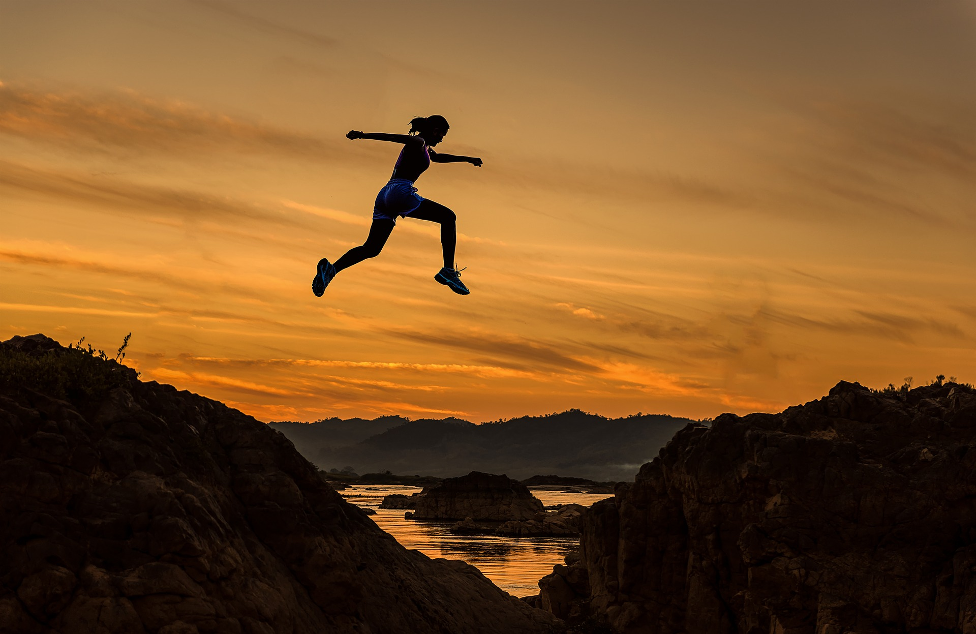 a woman jumping over hills - creating lifestyle goals