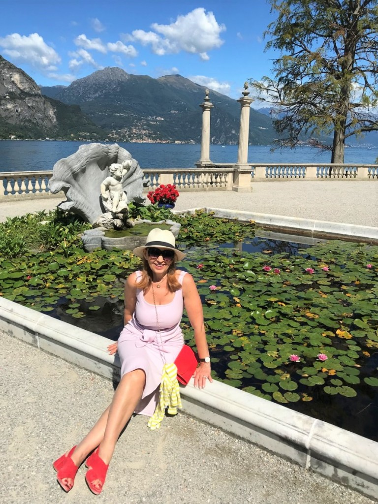 small pond and a woman sitting on the edge-Bellagio