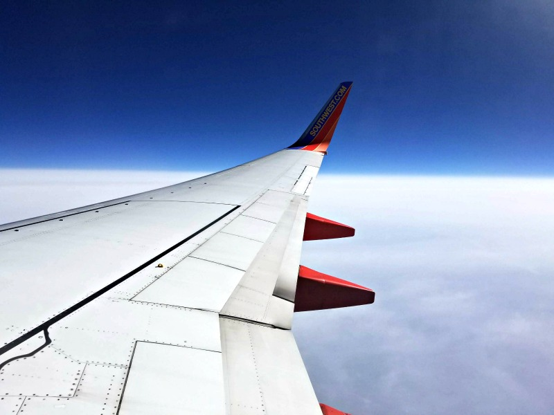 Southwest can be a quirky airline, but it's much more than just a bus in the sky. Follow these tricks and tips for flying Southwest to have the best experience possible. #familytravel #southwest #travelwithkids