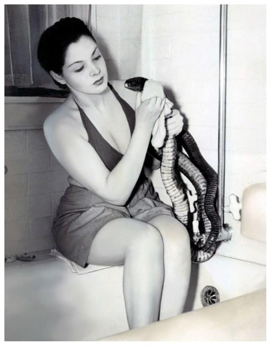 Burlesque dancer Miss Zorita walking her snake 1940s 2