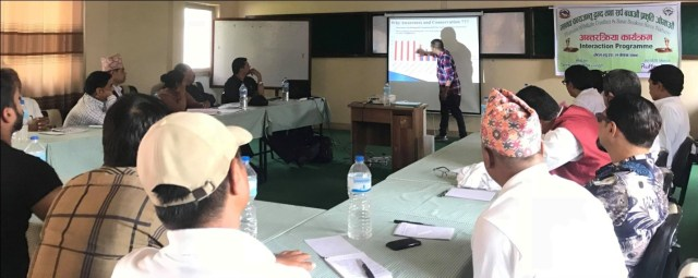 """Kamal presenting on his previous work """"Snakes and their Conservation in Rupandehi district, Nepal"""""""