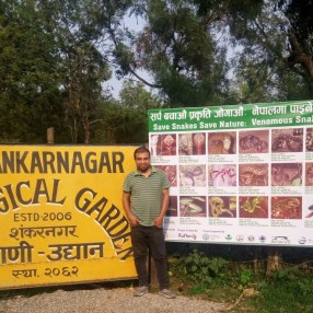 Researcher and Team Leader Kamal Devkota at the entrance of Zoological Garden after placing the snake identification board