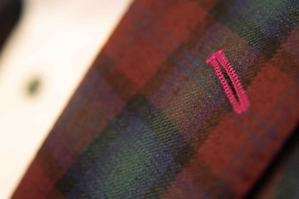 We are featuring holiday fabrics from Dormeuil: a solid red or beautiful red and green plaid.