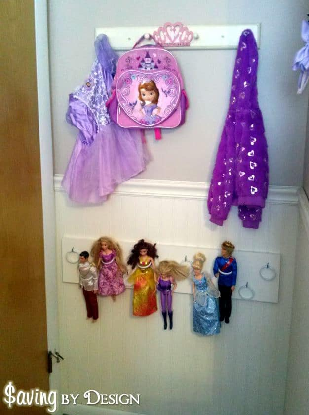 Need somewhere to store all of those Barbie or princess dolls? You'll love this cheap and easy DIY Barbie doll organizer!
