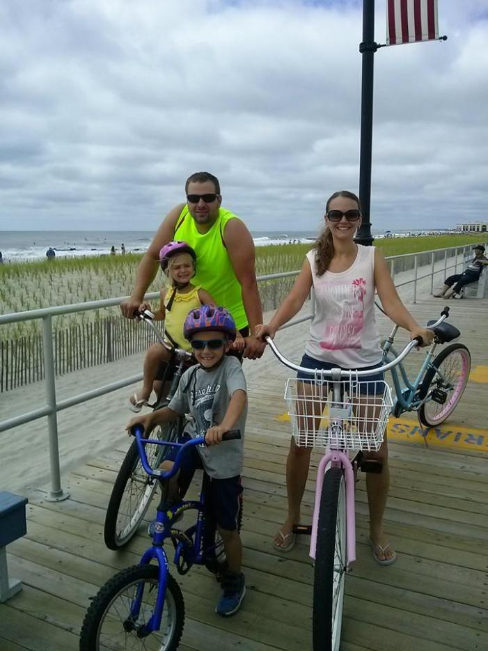 Ride bikes on the Ocean City boardwalk