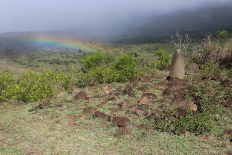 ancient Hawaiian temple with rainbow in background