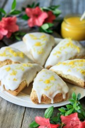Easy Glazed Lemon Scones: a simple and delicious dessert for breakfast, Easter brunch, bridal shower, or a ladies tea party. Each scone is topped with a tangy lemon glaze and a sprinkle of lemon zest for an casual yet elegant finish. Both kids and adults will love them! | www.savortheflavour.com #lemon #scones #Easter #teaparty #bridalshower