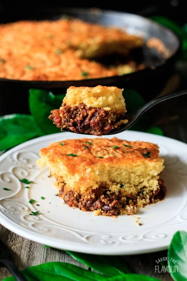 forkful of skillet chili cornbread with white plate