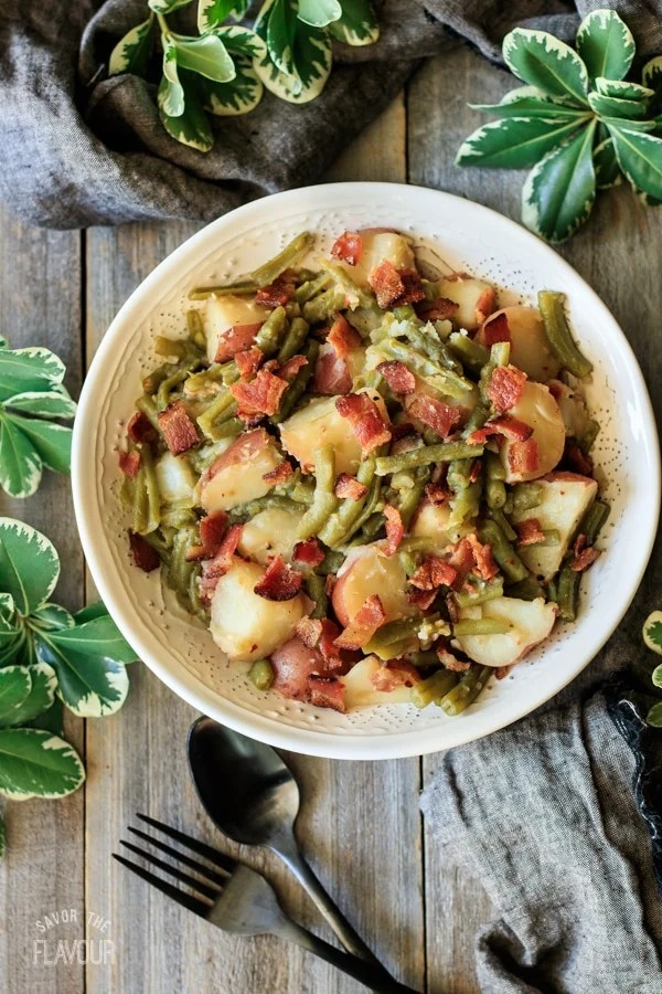 bowl of Southern green beans and potatoes with fork and spoon