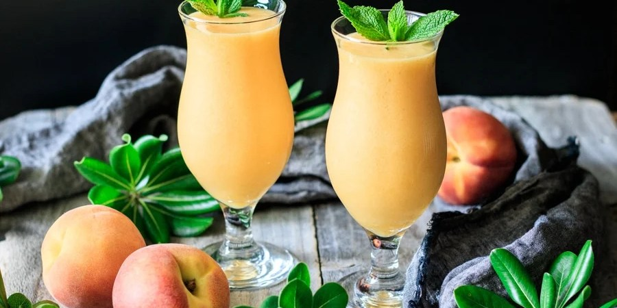 two virgin peach daiquiri drinks