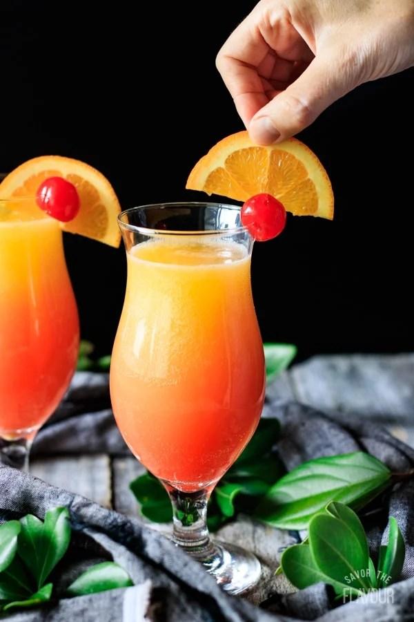 garnishing a sweet sunrise drink