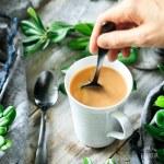 stirring a mug of French press coffee