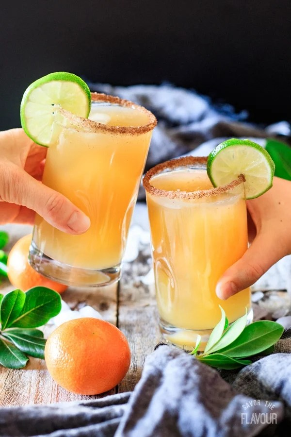 doing a toast with ginger beer mocktail with lime