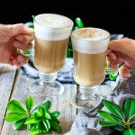 people doing a toast with two glasses of smoked butterscotch latte