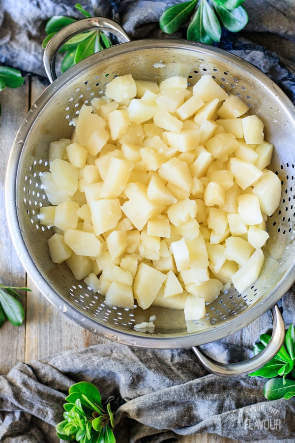 cooked potatoes in a colander for sour cream mashed potatoes