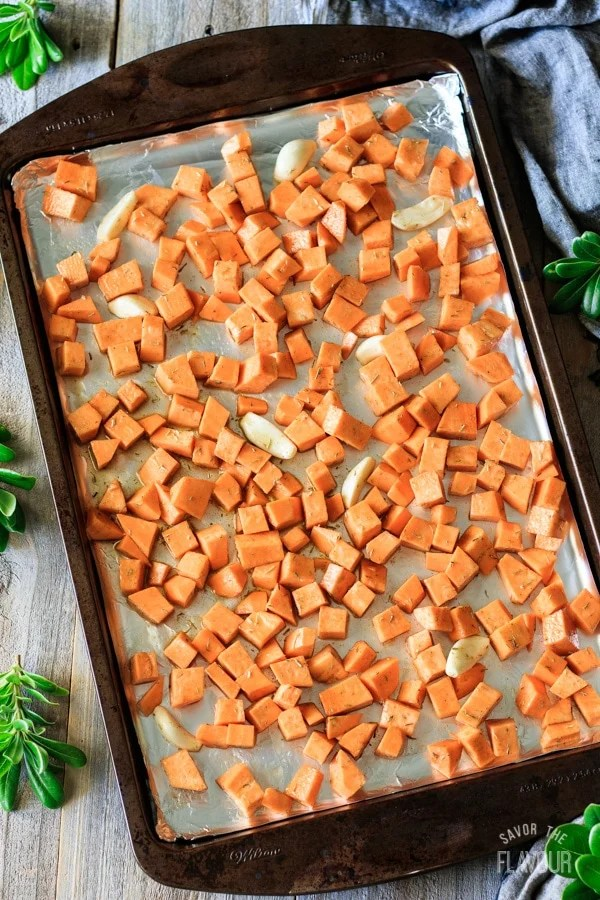 sweet potatoes on a tray for roasted sweet potatoes