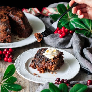 holding a forkful of plum pudding
