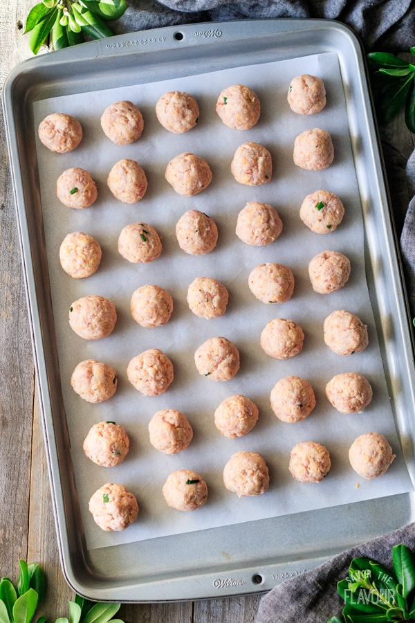 unbaked cheesy sausage balls on a tray