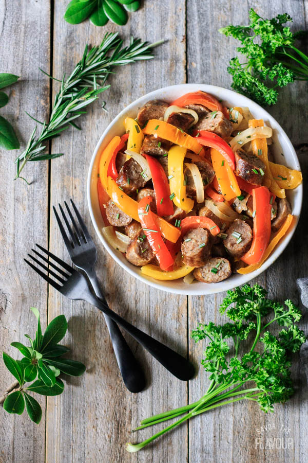 bowl of Italian sausage, peppers, and onions with two forks