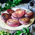 holding one of the marinated red onions on a spoon
