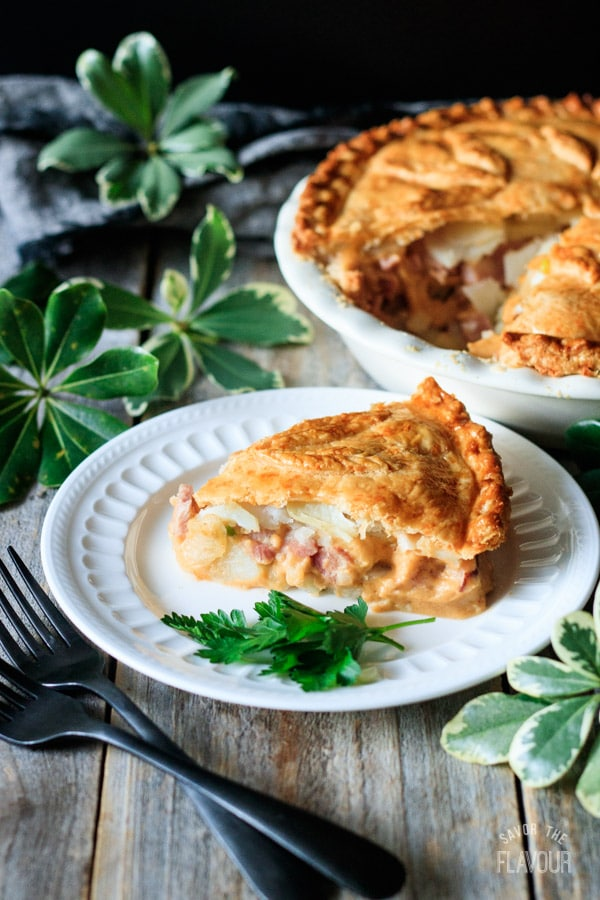 slice of ham and potato pie with two forks