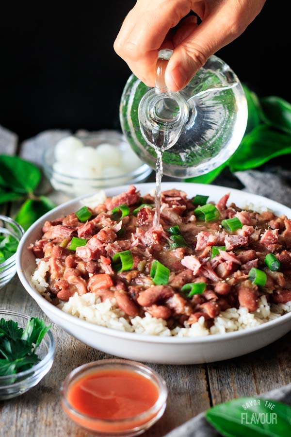 pouring white vinegar on red beans and rice