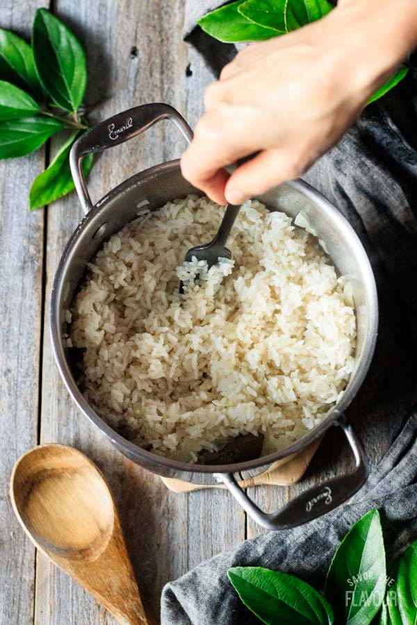fluffing rice for red beans and rice