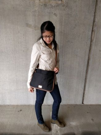 wearing the CK Nylon Messenger Bag cross-body style