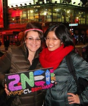 wearing the Ann Taylor Red Chunky Infinity Scarf at a 2NE1 concert