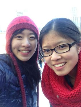 wearing the AT Red Chunky Infinity Scarf while ice skating at Bryant Park Ice Rink