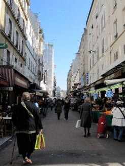 It'd be fun to shop on a street like Rue de Levis everyday photo - Karen Anderson