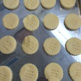 lift the cookies to a baking tray and bake in a low temperature oven until golden