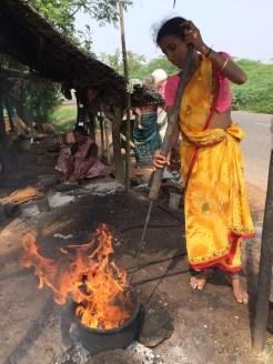 Young woman roasting cashews - photo credit - Karen Anderson @savouritall
