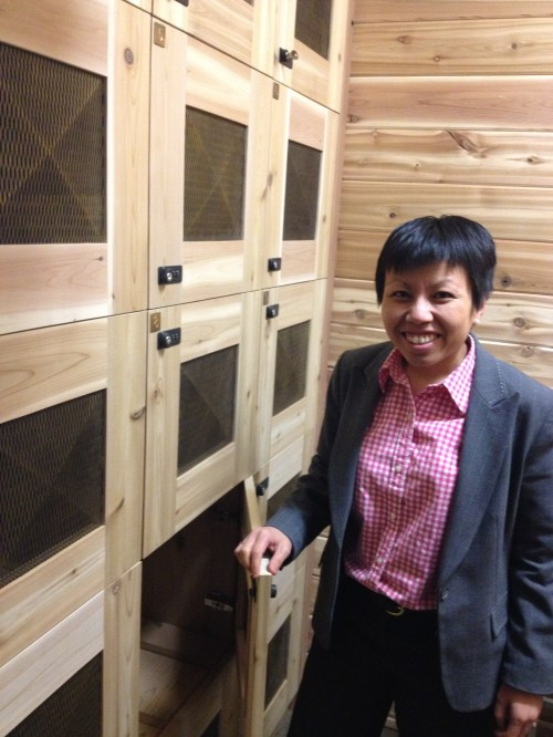 Phoebe Fun, owner of Vin Room Wine with the wall of private wine lockers available at her store