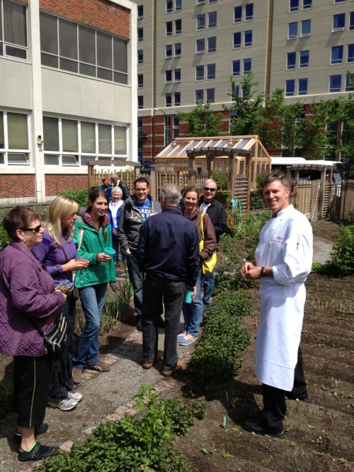 Chef Andrew Hewson with guests in Jackson's Garden - the culinary garden at SAIT that he helped design and build photo - Karen Anderson