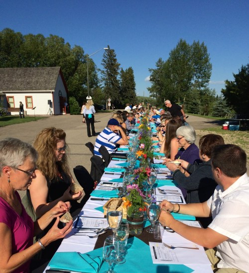 Alberta blue skies make for long table dinner magic - photo - Karen Anderson