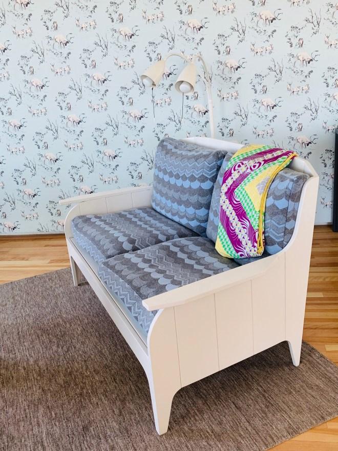 Wallpaper and cozy Fogo Island Woodshop furniture