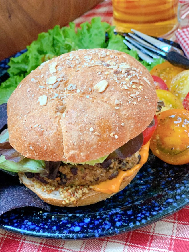 Yonder Black Bean Burger - fully dressed on a bun with sides
