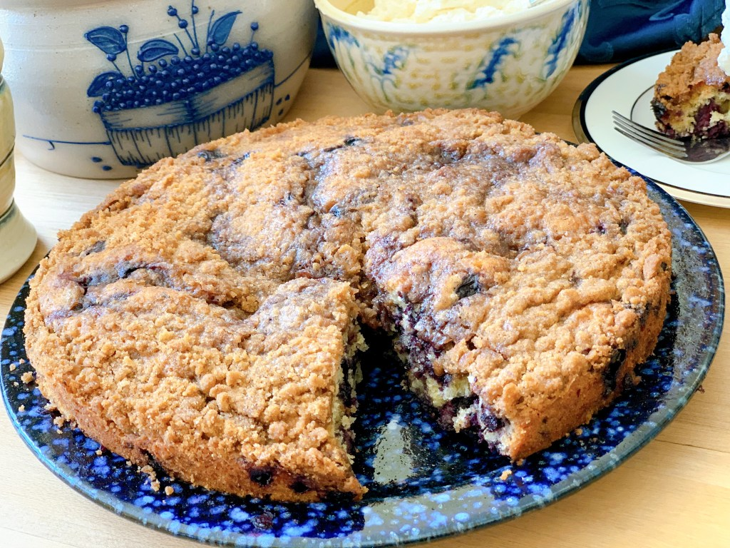 Wild Blueberry Buckle - whole cake with slice out of it