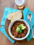 Serving suggestion with a side of bread and a beer shown here for Five Bean Pork and Beans