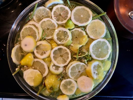 Elderflowers, lemons, syrup and citric acid all mixed together to steep for 24 hours