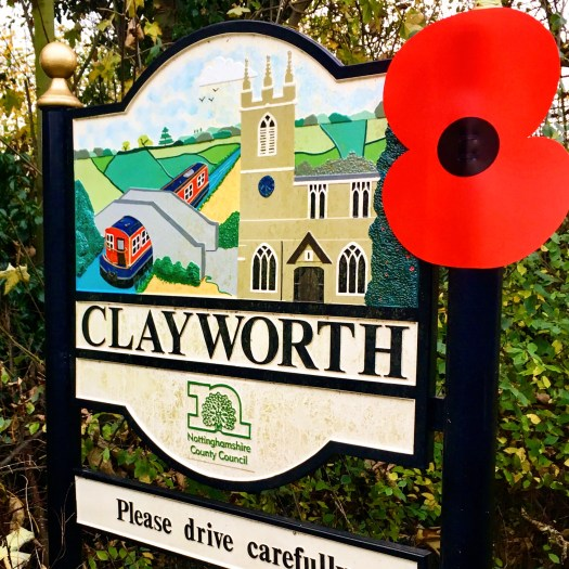 Nottinghamshire village name signs with poppy