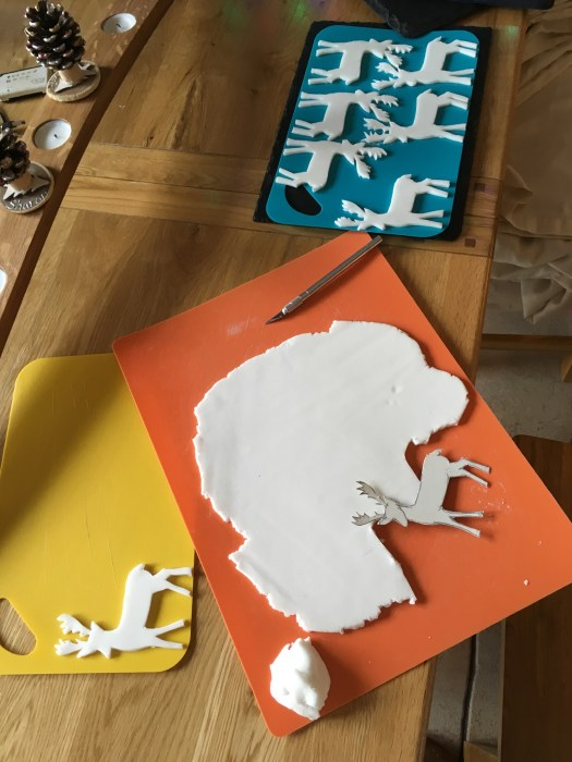 Carefully cut out reindeers shapes using a card template