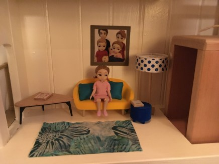 Living room: homemade rug and family portrait