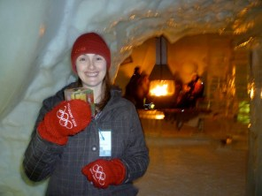 Enjoying a drink in my ice glass at the Ice Bar, in front of the fireplace.