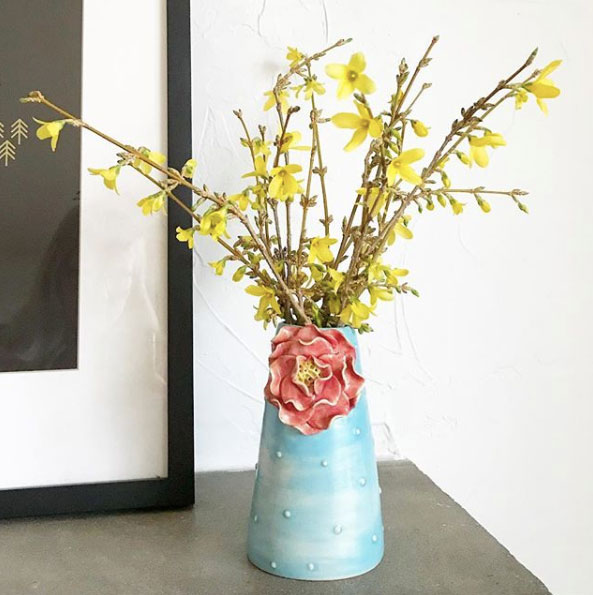 forced forsythia branches in a vase