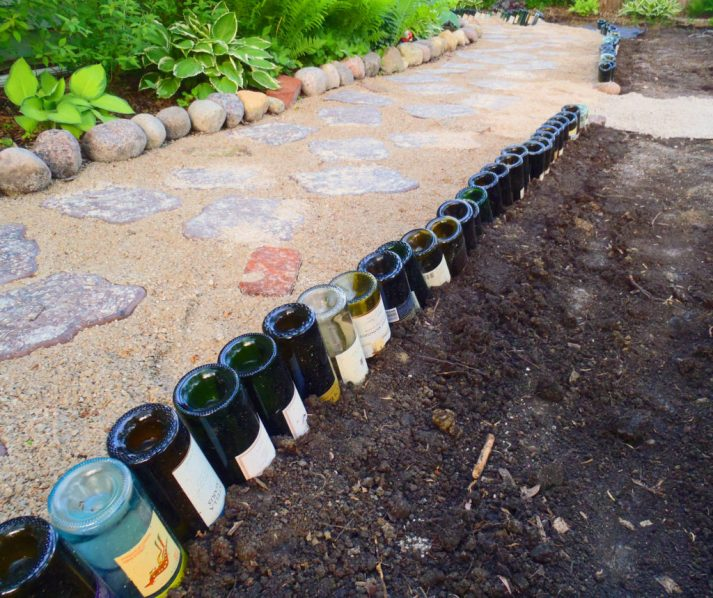 Add a DIY flair to garden beds with a simple garden hack - a wine bottle edge!